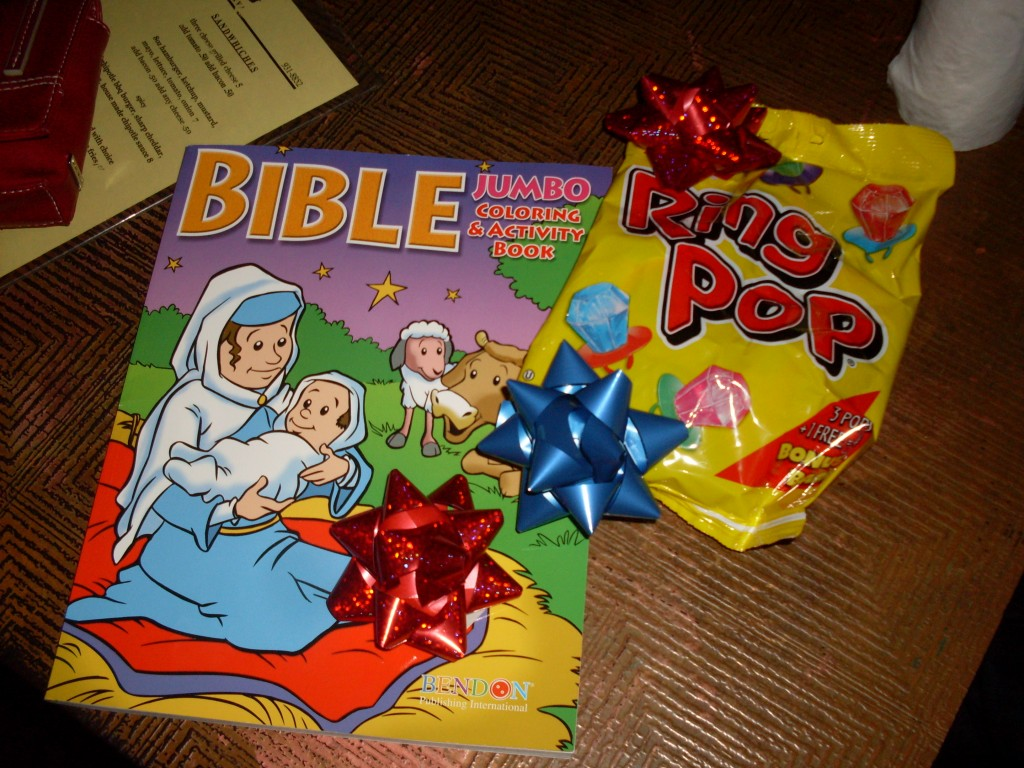 coloring book and candy on table