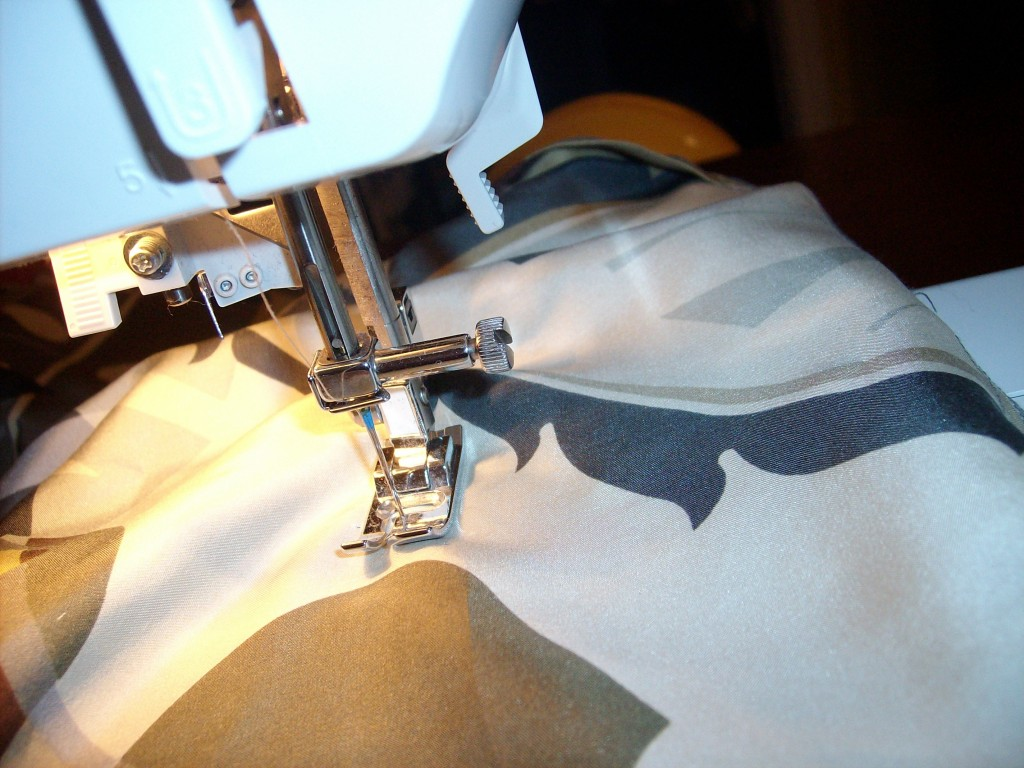 sewing new side seam of dress.