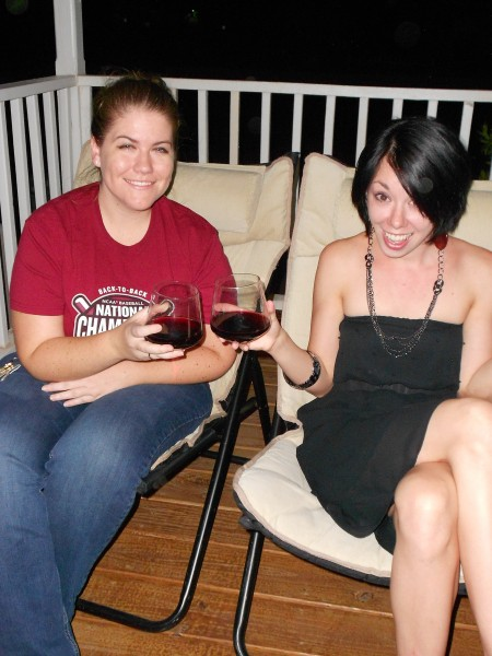 Jillian and Katherine toasting on porch