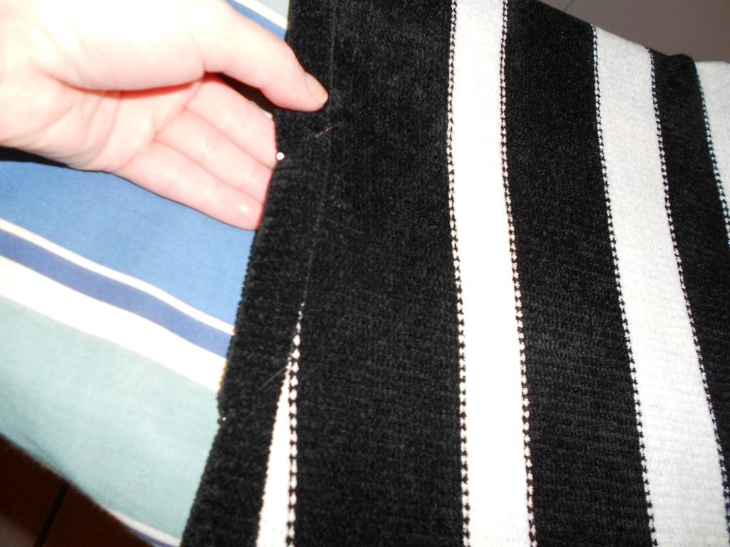 pinning new neckline of sweater