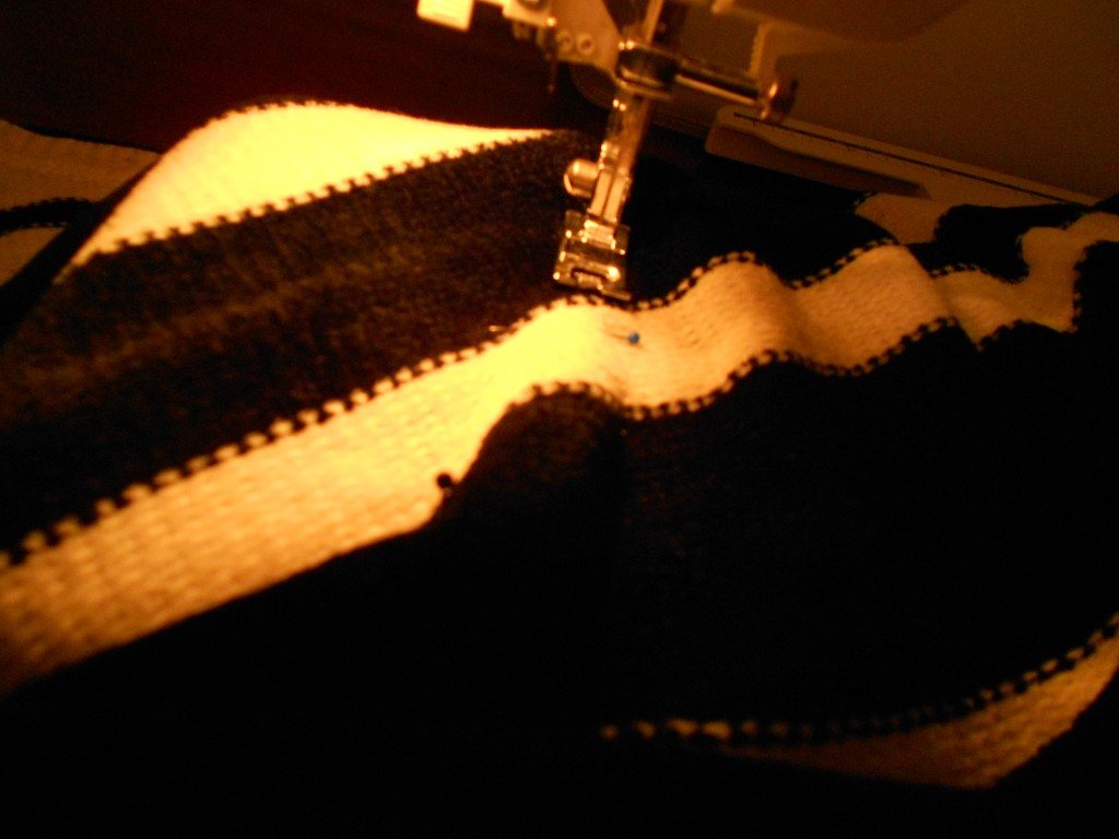 taking sweater in on sewing machine