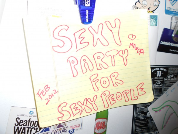 """sign on fridge that reads """"Sexy party for sexy people"""""""