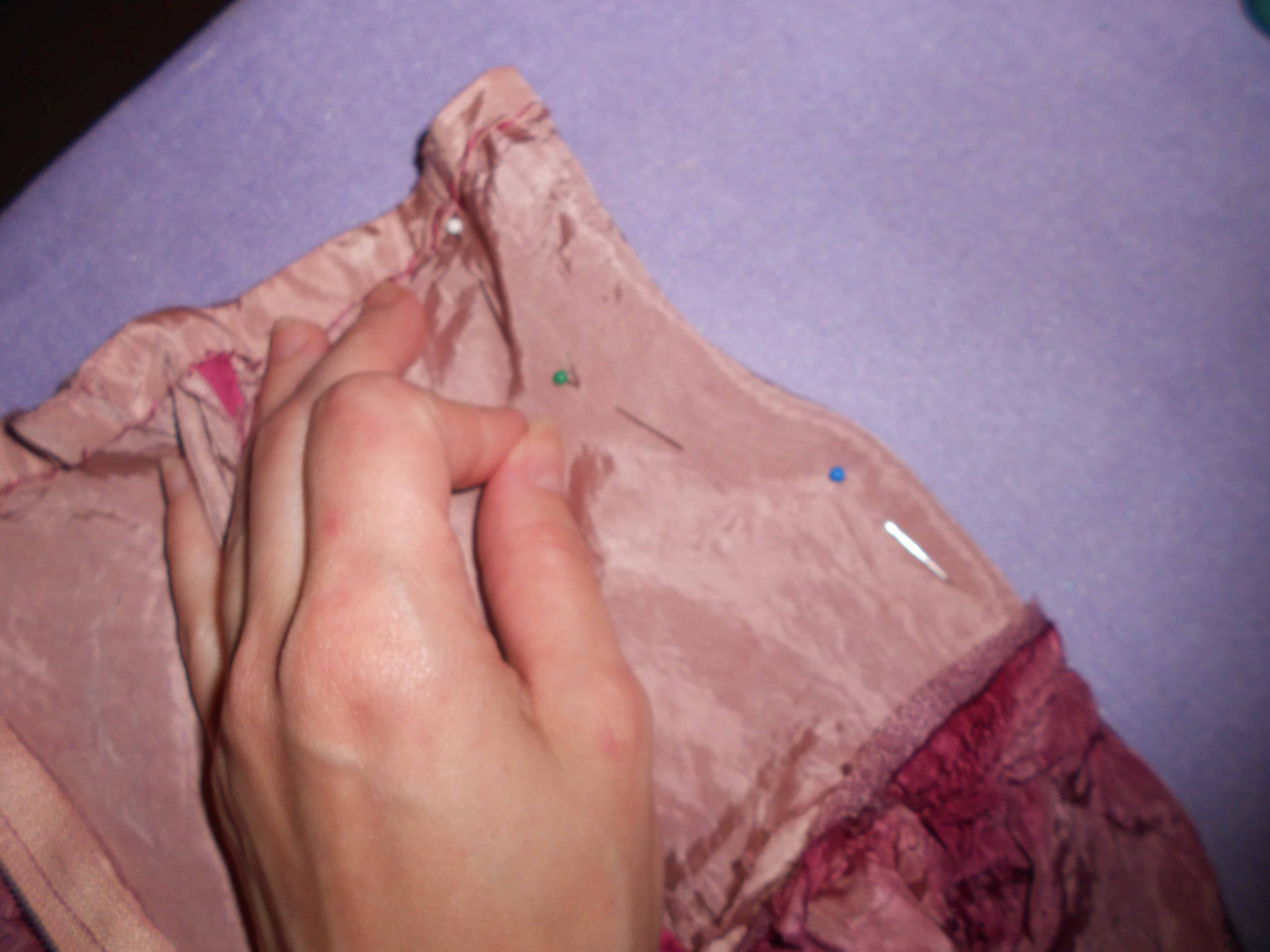 pinning sides of dress