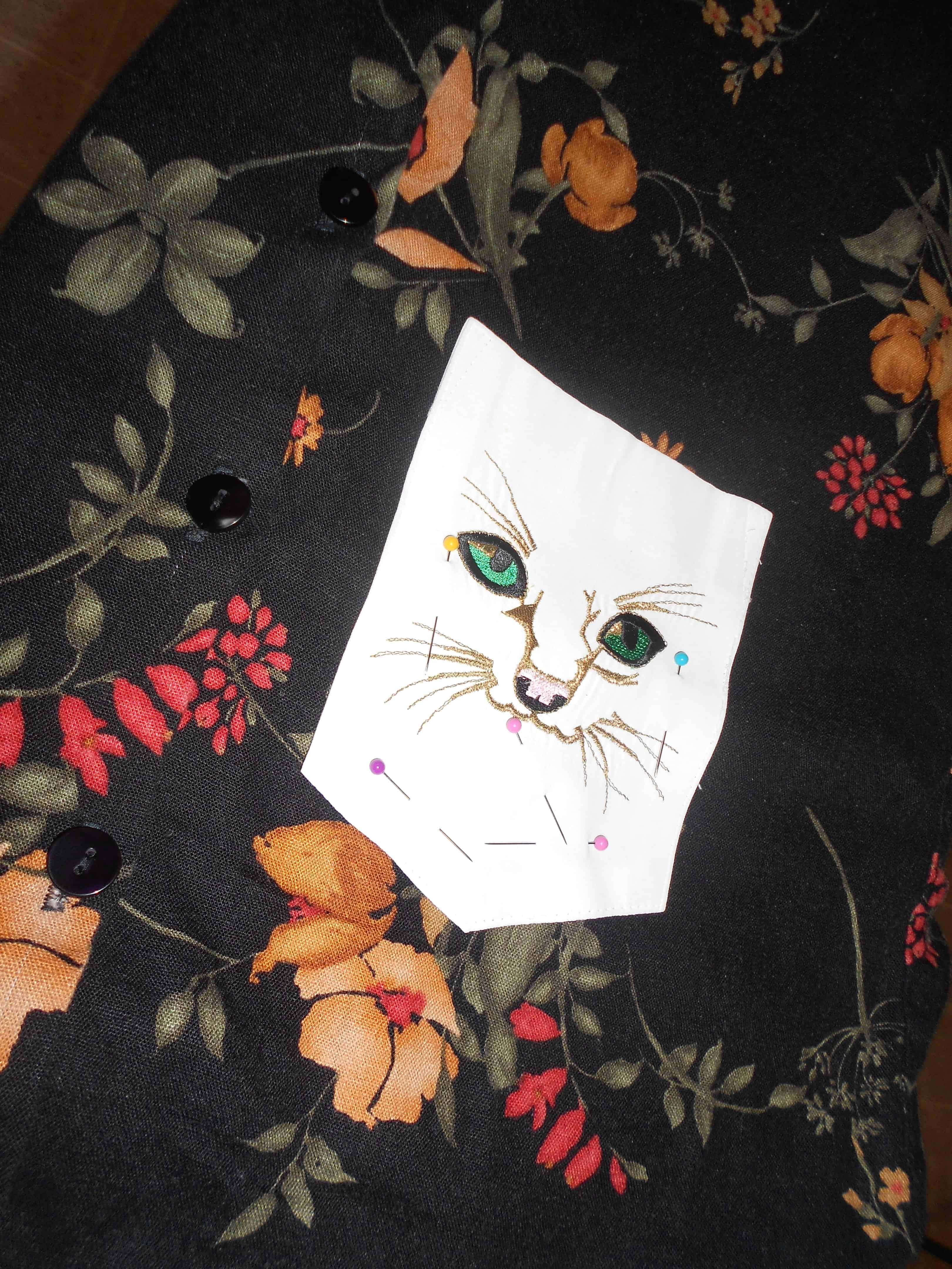 cat pocket pinned to bottom of dress