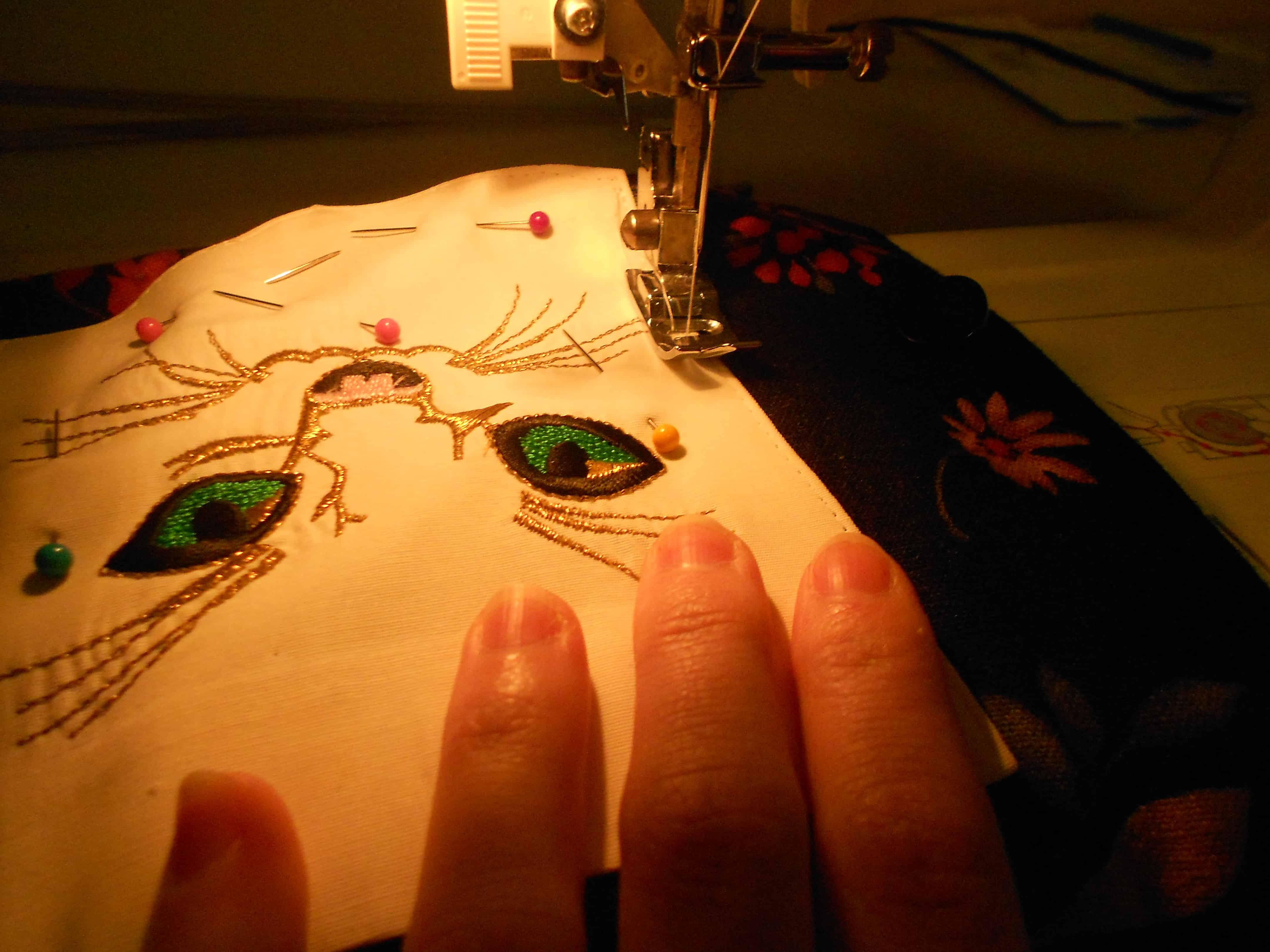 sewing cat pocket onto dress