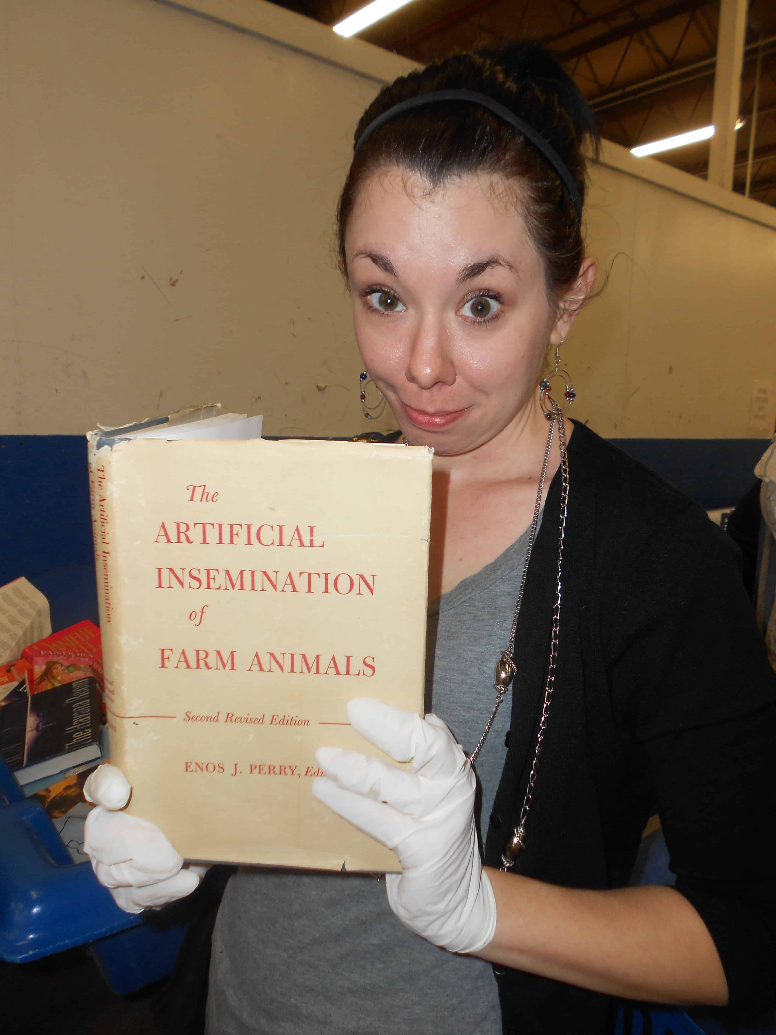 refashionista holding up book titled the artificial insemination of farm animals
