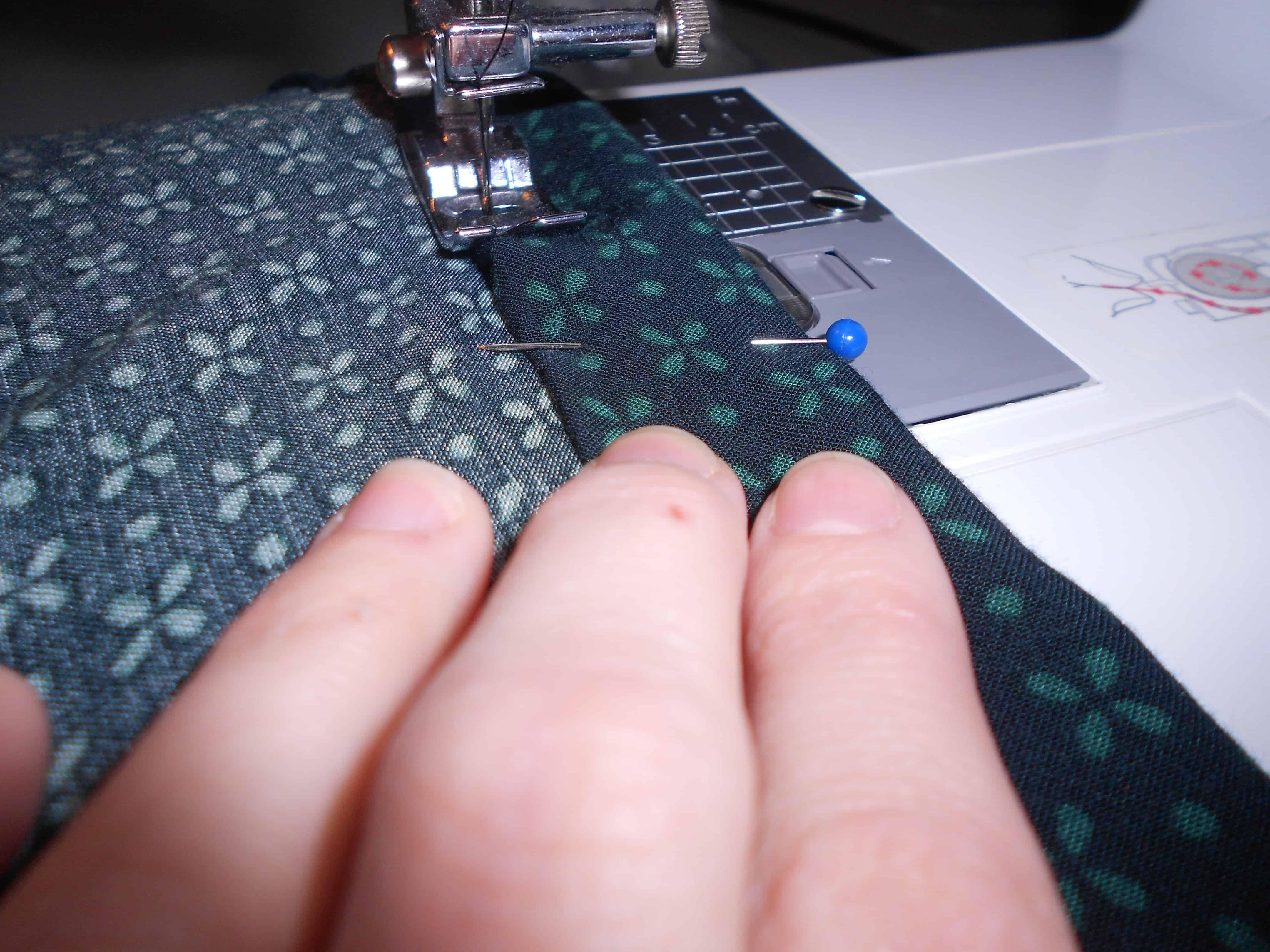 sewing new hem of dress