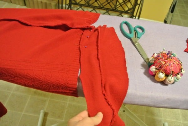 pinning side scrap to bottom of sweater