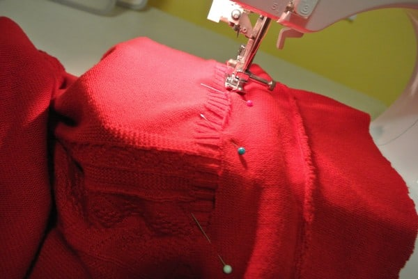 sewing scrap on bottom of sweater