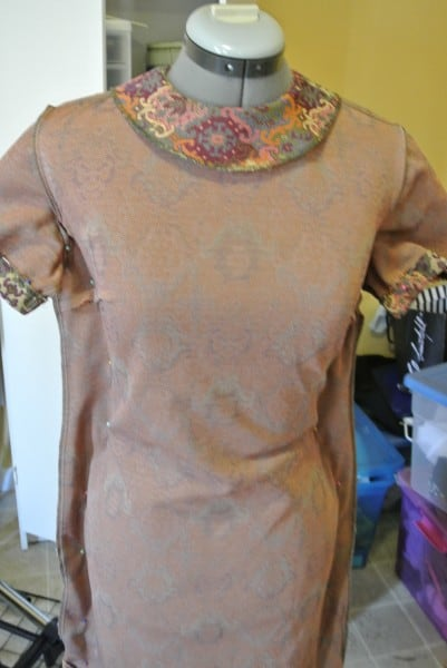 Dress pinned on dress form