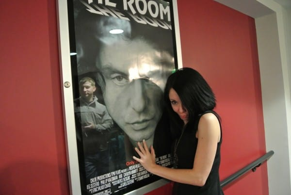 jillian in front of The Room film poster