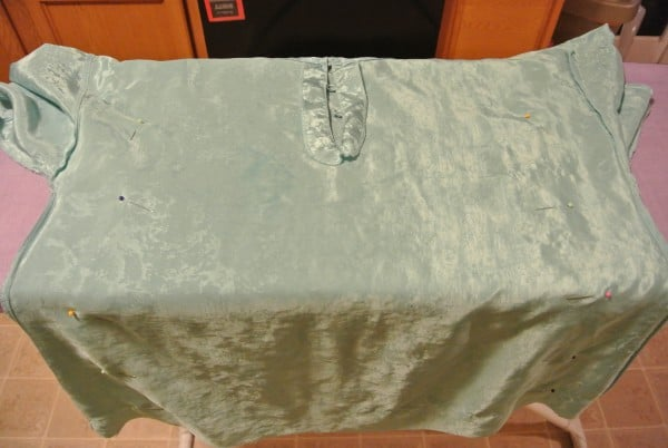 pinned sides of nightgown