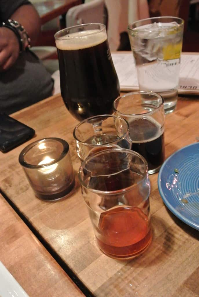 flight of beers on table