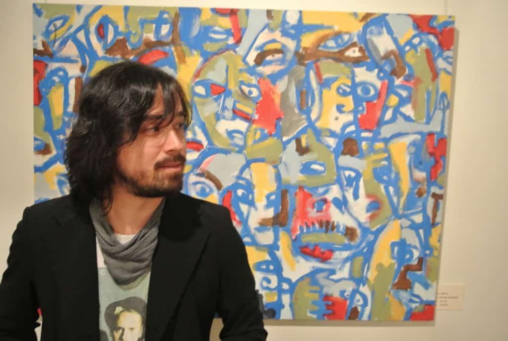 Michael krajewski standing in front of his art