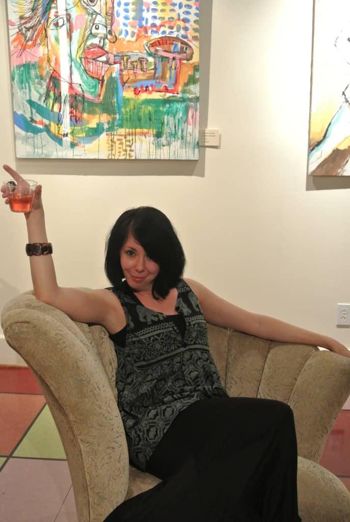 Jillian drinking wine on couch