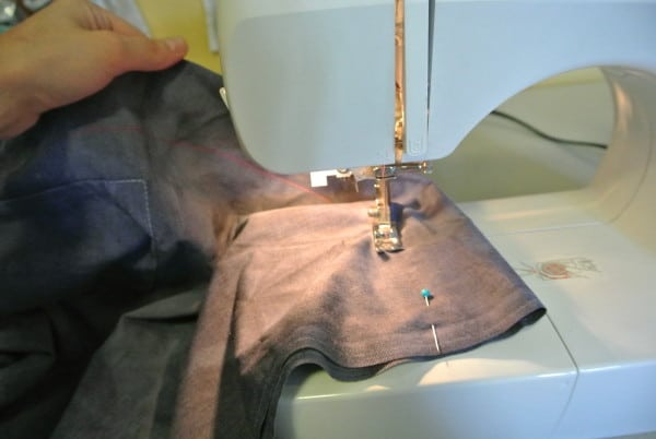 taking scrub top refashion in on sewing machine