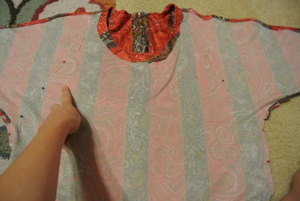 Pinning along sleeves to refashion skirt