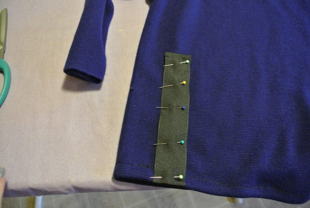pinned ribbon on sweater