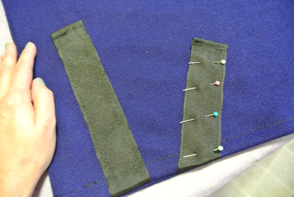 Pinning second ribbon to sweater