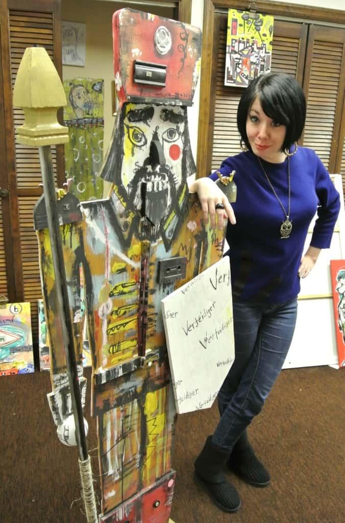 Jillian posing next to art