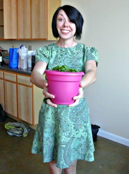 jillian holding a basil plant