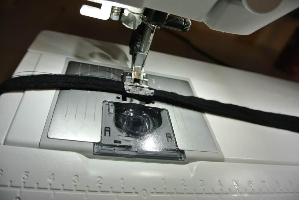 stitching refashioned sash for dress