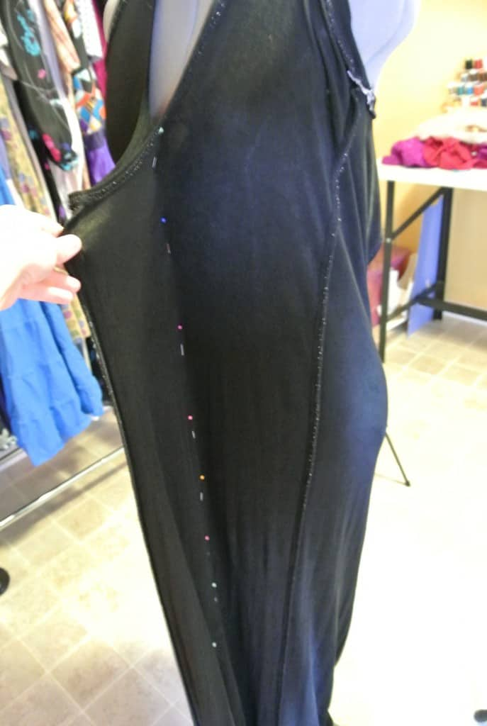 pinning dress on dress form