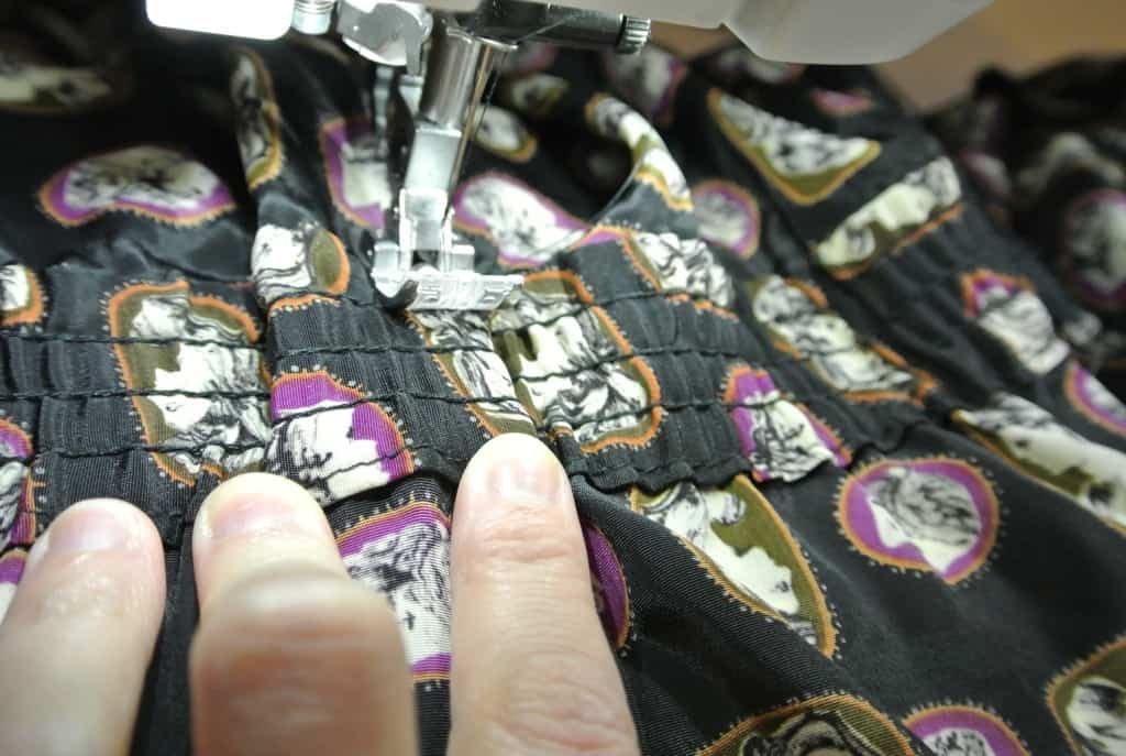 stitching each side of the leftover elastic down, so it lays flat
