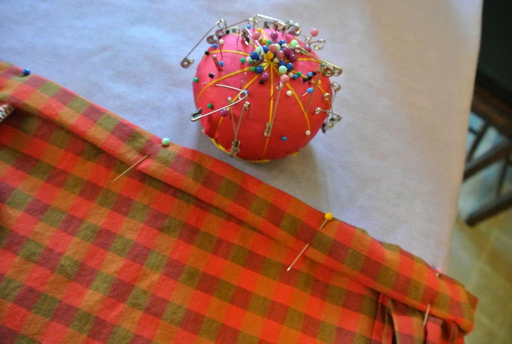 pinning bottom hem of dress