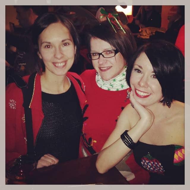 Jillian, Erin, and Karen in Christmas sweaters