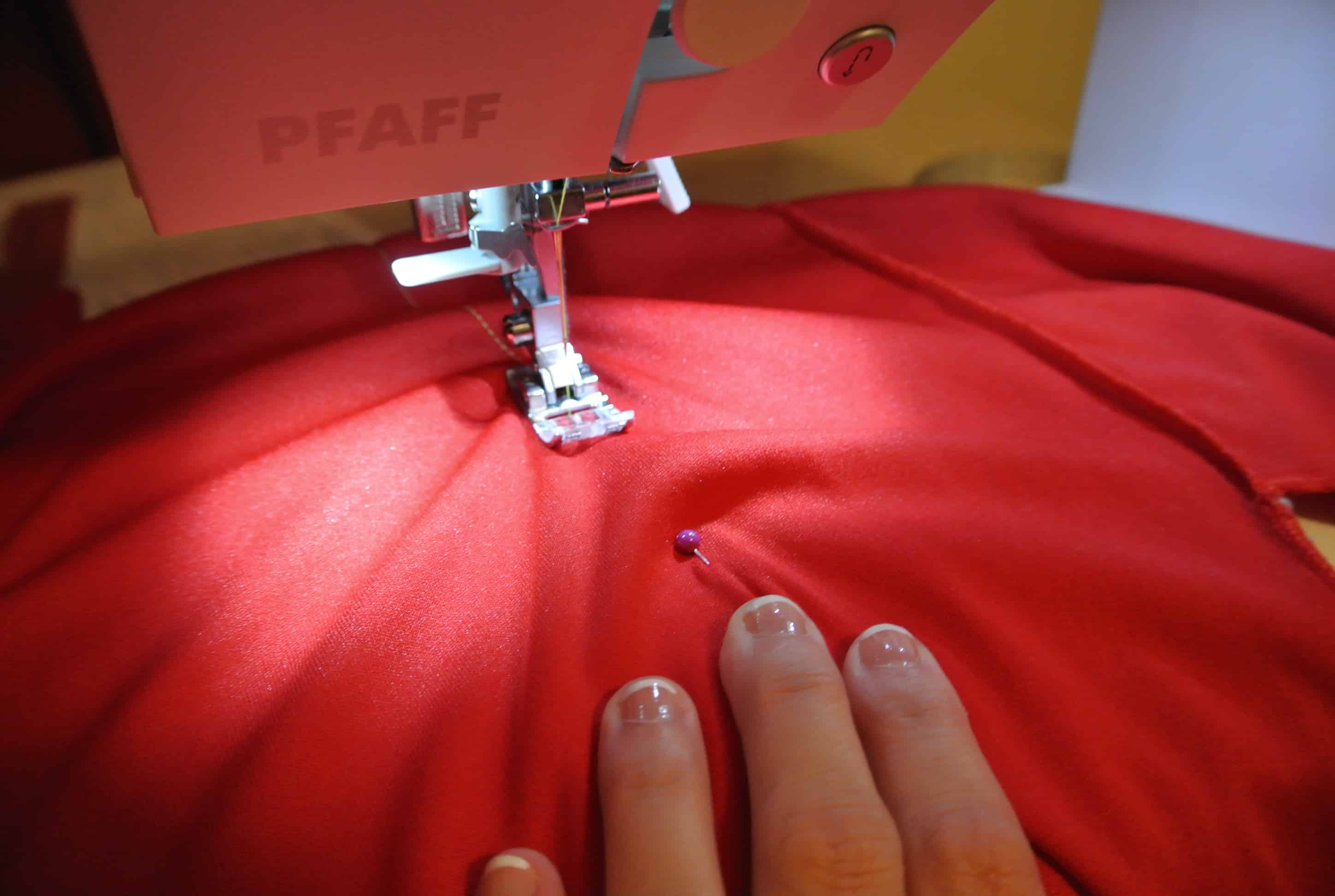 taking in dress on sewing machine