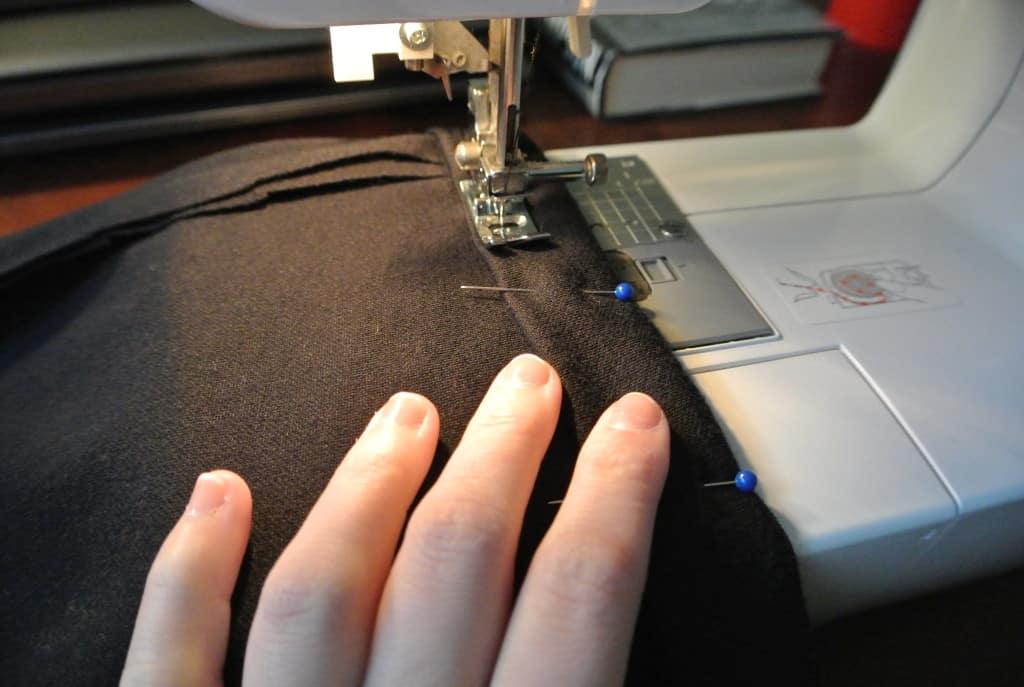 Sewing hem of dress on sewing machine