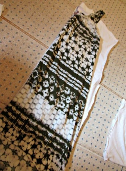 dress folded in half over shirt folded in half