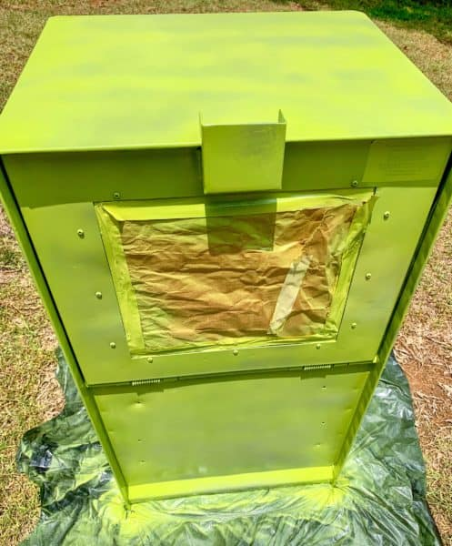 newspaper box spray painted green