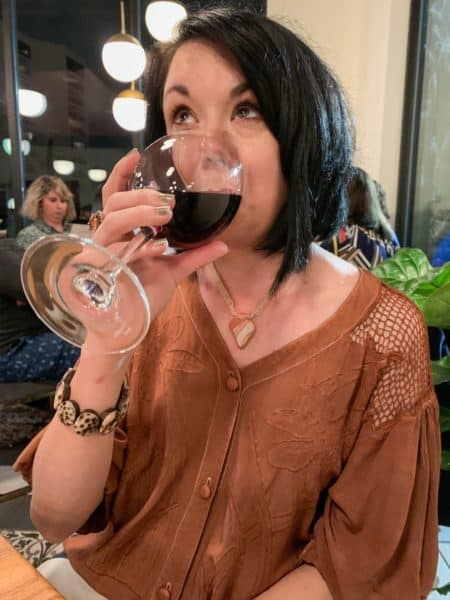 ReFashionista drinks wine