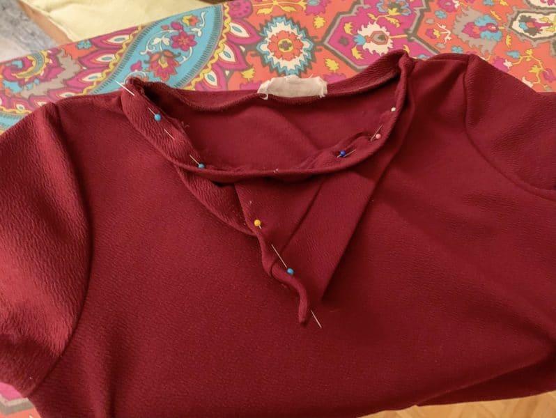 pinning detail into neckhole binding