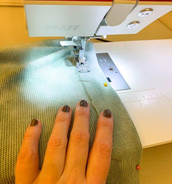 refashionista sewing hem on jar dyed sweater