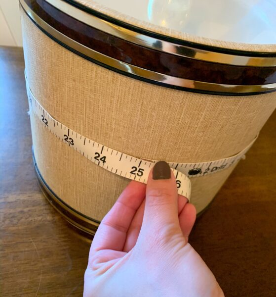 Refashionista measuring ice bucket for upcycle