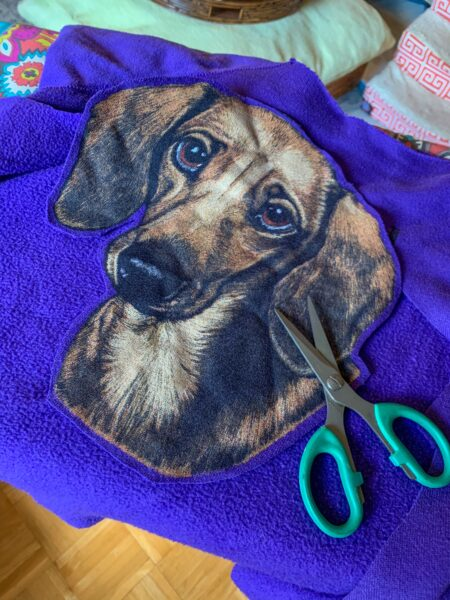 refashionista cutting out dachshund for applique