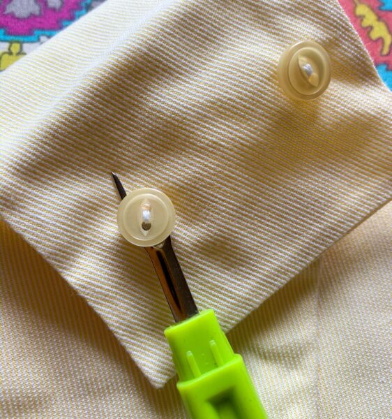 seam ripping off buttons