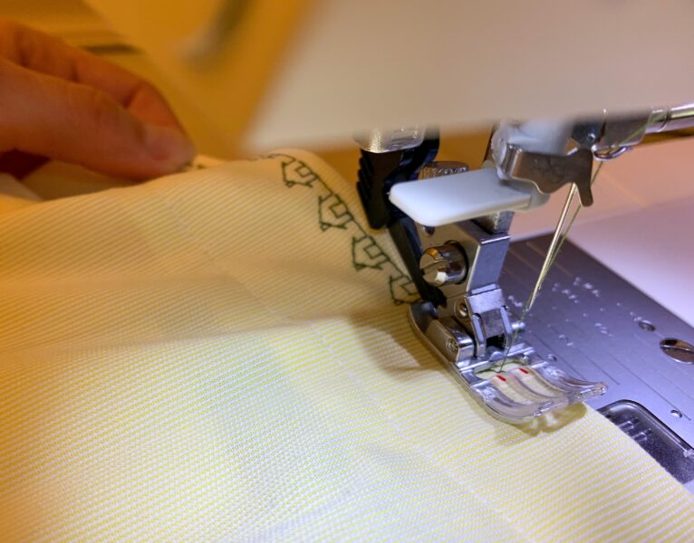 decorative house stitch being added to hem