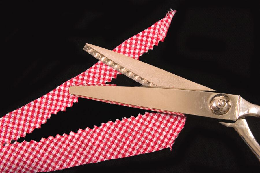 pinking shears cutting fabric