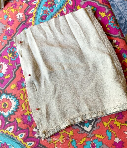 pinning raw edge of fabric scrap for face mask