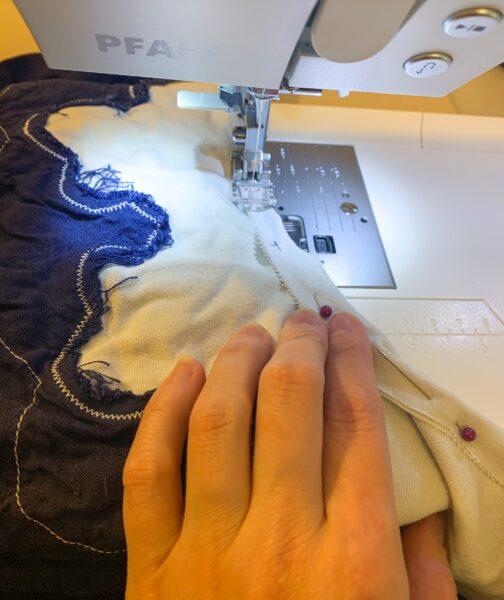stitching down new neckline