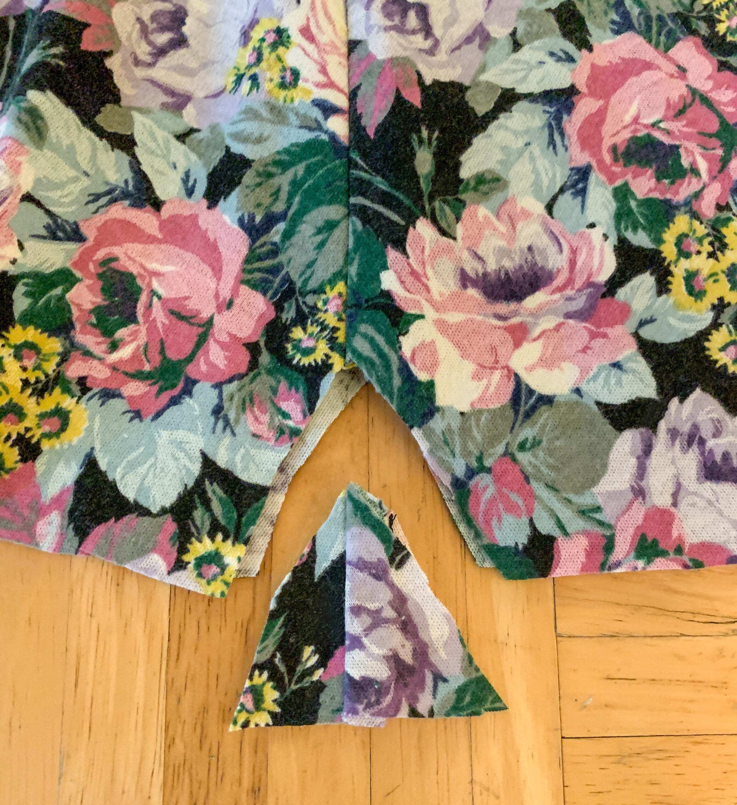 snipping fabric from dress to make romper