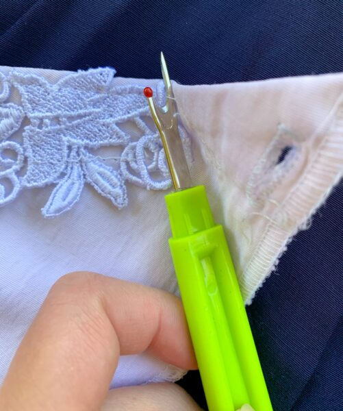 unpicking lace from collar