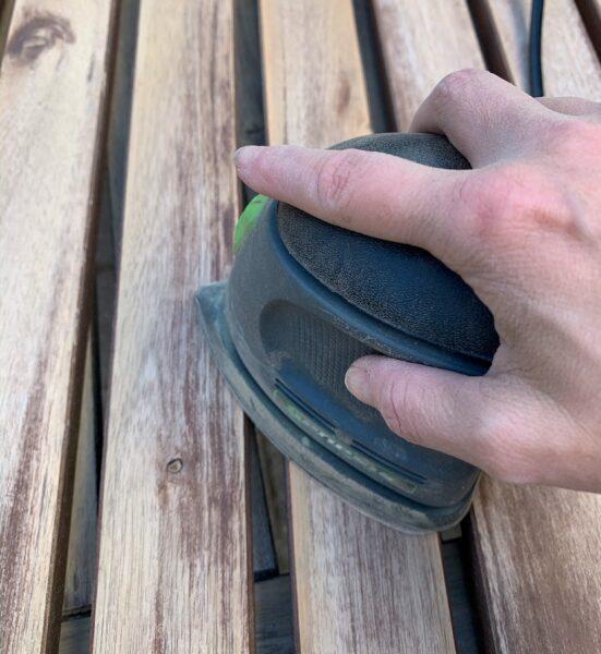 using electric hand sander