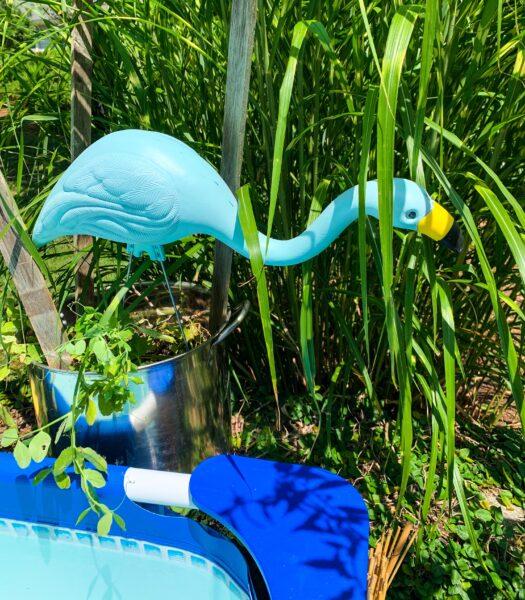 blue yard flamingo in pot