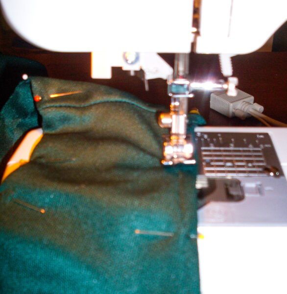 stitching down neckline of dress