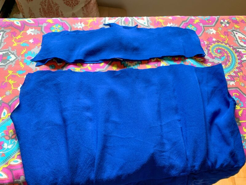 Chopping off more fabric from the top of the dress